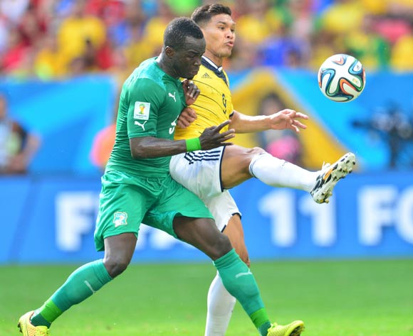 Teofilo Gutierrez of Colombia clears from Ismael Tiote of Ivory Coast during the 2014 Brazil World Cup Final Group C football match between Colombia and Ivory Coast at the Estadio Nacional Brasilia, Brazil on 19 June 2014
