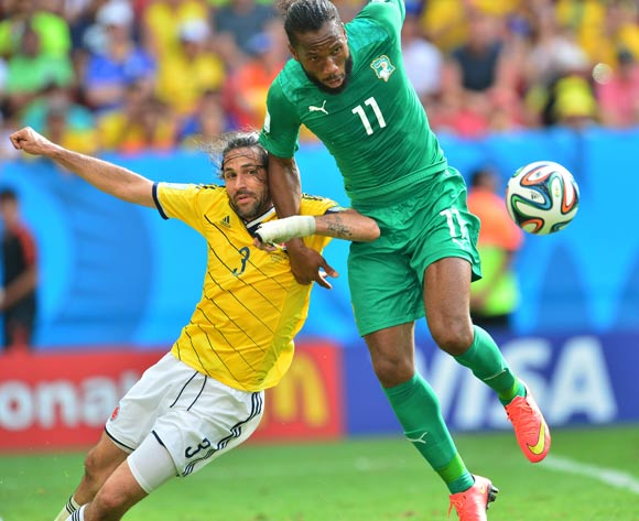 Didier Drogba of Ivory Coast  and Cristian Zapata of Colombia challenge for the ball during the 2014 Brazil World Cup Final Group C football match between Colombia and Ivory Coast at the Estadio Nacional Brasilia, Brazil on 19 June 2014