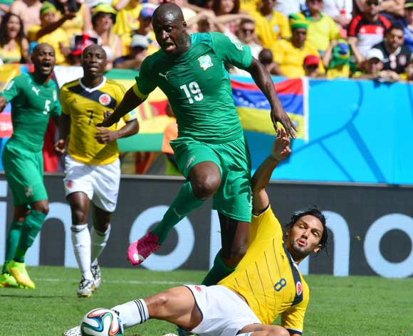 Yaya Toure of Ivory Coast evades tackle from Abel Aguilar of Colombia  during the 2014 Brazil World Cup Final Group C football match between Colombia and Ivory Coast at the Estadio Nacional Brasilia, Brazil on 19 June 2014