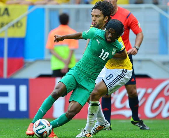 Gervinho of Ivory Coast held back by Abel Aguilar of Colombia  during the 2014 Brazil World Cup Final Group C football match between Colombia and Ivory Coast at the Estadio Nacional Brasilia, Brazil on 19 June 2014