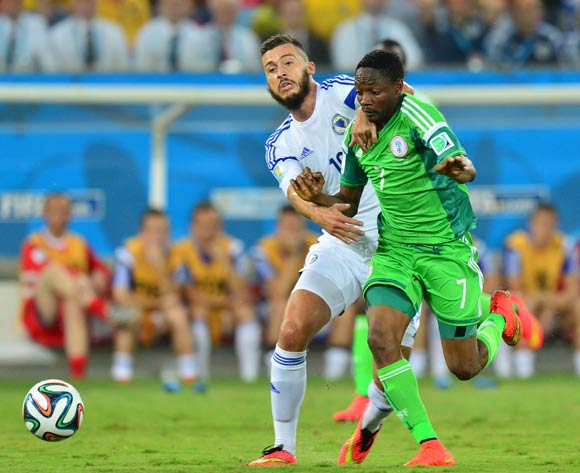 Ahmed Musa of Nigeria held back by Haris Medunjanin of Bosnia and Herzegovina during the 2014 Brazil World Cup Final Group F football match between Nigeria and Bosnia at the Arena Pantanal in Cuiaba, Brazil on 21 June 2014
