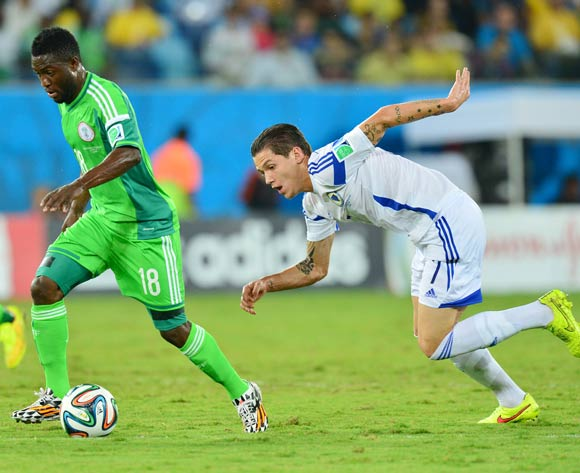 Michael Babatunde of Nigeria gets away from Muhamed Besic of Bosnia and Herzegovina during the 2014 Brazil World Cup Final Group F football match between Nigeria and Bosnia at the Arena Pantanal in Cuiaba, Brazil on 21 June 2014