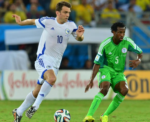 Zvjezdan Misimovic of Bosnia and Herzegovina gets away from Efe Ambrose of Nigeria  during the 2014 Brazil World Cup Final Group F football match between Nigeria and Bosnia at the Arena Pantanal in Cuiaba, Brazil on 21 June 2014