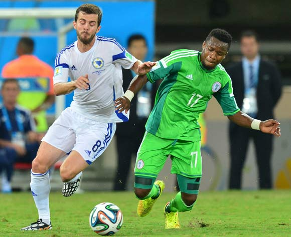 Miralem Pjanic of Bosnia and Herzegovina challenged by Ogenyi Onazi of Nigeria during the 2014 Brazil World Cup Final Group F football match between Nigeria and Bosnia at the Arena Pantanal in Cuiaba, Brazil on 21 June 2014