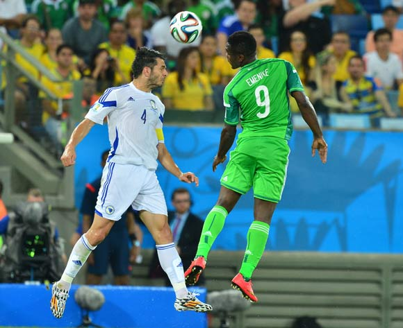 Emir Spahic of Bosnia and Herzegovina and Emmanuel Emenike of Nigeria challenge for the ball during the 2014 Brazil World Cup Final Group F football match between Nigeria and Bosnia at the Arena Pantanal in Cuiaba, Brazil on 21 June 2014