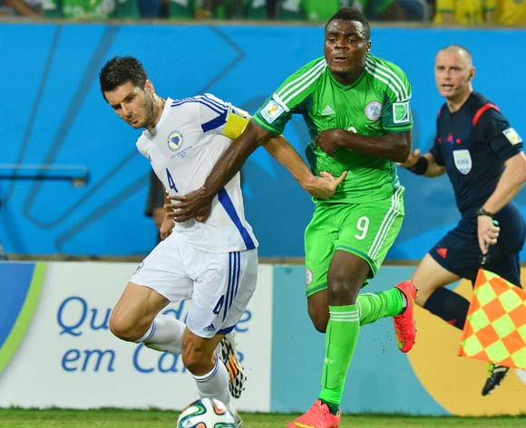 Emenike powers past Emir Spahic of Bosnia