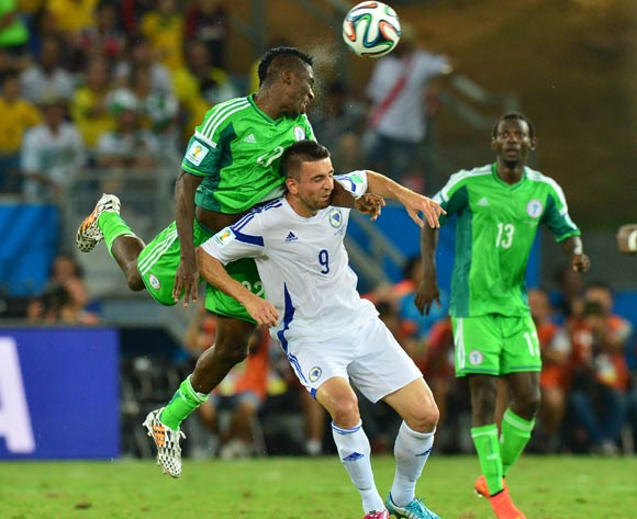 Kenneth Omeruo of Nigeria wins ball from Vedad Ibisevic of Bosnia and Herzegovina  during the 2014 Brazil World Cup Final Group F football match between Nigeria and Bosnia at the Arena Pantanal in Cuiaba, Brazil on 21 June 2014