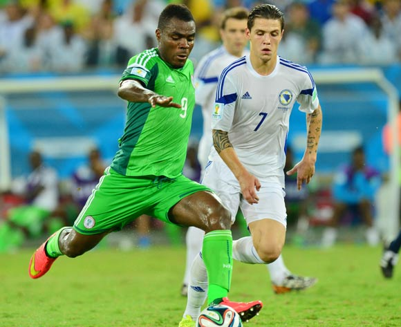 Emmanuel Emenike of Nigeria shoots despite challenge from Muhamed Besic of Bosnia and Herzegovina during the 2014 Brazil World Cup Final Group F football match between Nigeria and Bosnia at the Arena Pantanal in Cuiaba, Brazil on 21 June 2014