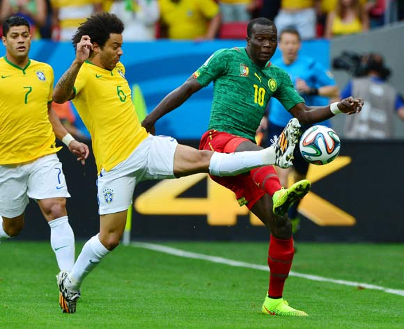 Marcelo of Brazil challenges Vincent Aboubakar of Cameroon  during the 2014 Brazil World Cup Final Group A football match between Cameroon and Brazil at the Estadio Nacional Brasilia, Brazil on 23 June 2014