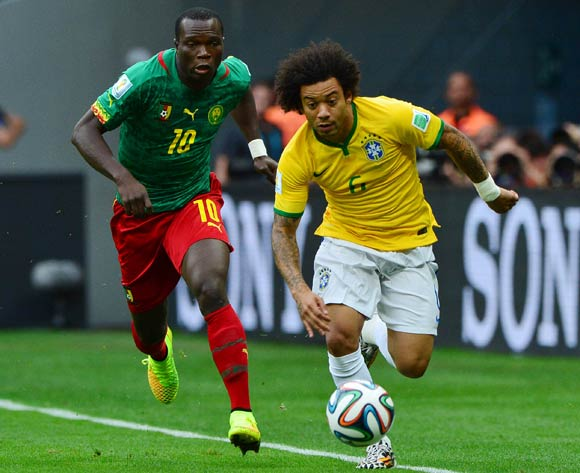 Marcelo of Brazil gets away from Vincent Aboubakar of Cameroon  during the 2014 Brazil World Cup Final Group A football match between Cameroon and Brazil at the Estadio Nacional Brasilia, Brazil on 23 June 2014