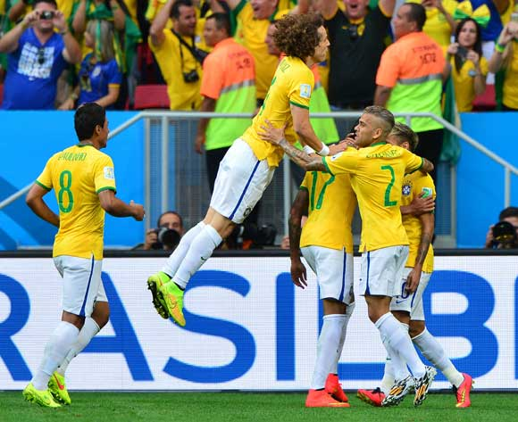 David Luiz of Brazil jumps in celebration of Neymar's (r) goal  during the 2014 Brazil World Cup Final Group A football match between Cameroon and Brazil at the Estadio Nacional Brasilia, Brazil on 23 June 2014
