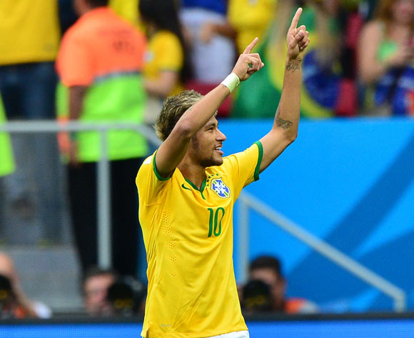 Neymar of Brazil celebrates goal  during the 2014 Brazil World Cup Final Group A football match between Cameroon and Brazil at the Estadio Nacional Brasilia, Brazil on 23 June 2014