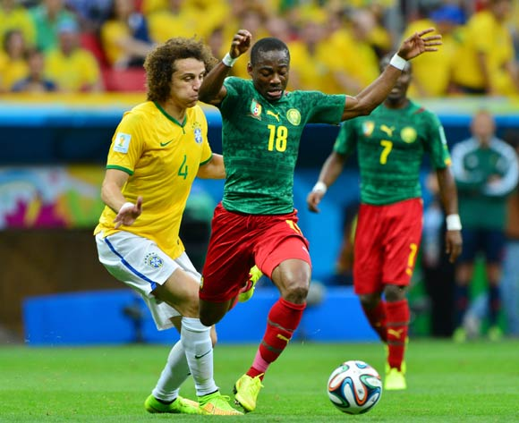 David Luiz of Brazil fouls Eyong Enoh of Cameroon  during the 2014 Brazil World Cup Final Group A football match between Cameroon and Brazil at the Estadio Nacional Brasilia, Brazil on 23 June 2014