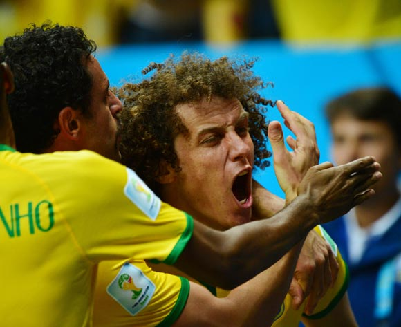 David Luiz screams in celebration with goalscorer Fred (c) during the 2014 Brazil World Cup Final Group A football match between Cameroon and Brazil at the Estadio Nacional Brasilia, Brazil on 23 June 2014