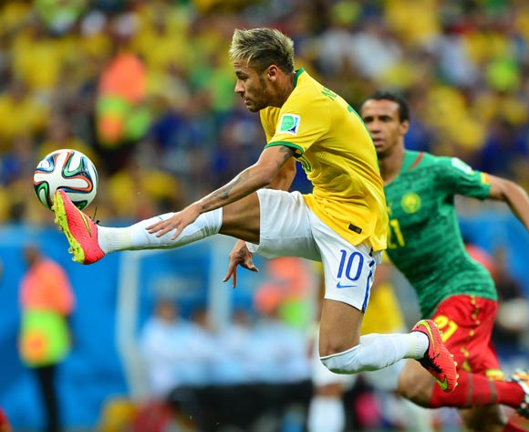 Neymar of Brazil controls ball during the 2014 Brazil World Cup Final Group A football match between Cameroon and Brazil at the Estadio Nacional Brasilia, Brazil on 23 June 2014