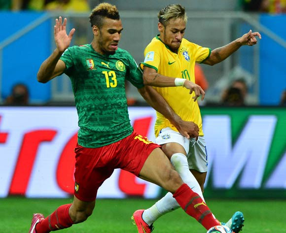 Eric Choupo-Moting of Cameroon tackles Neymar of Brazil during the 2014 Brazil World Cup Final Group A football match between Cameroon and Brazil at the Estadio Nacional Brasilia, Brazil on 23 June 2014