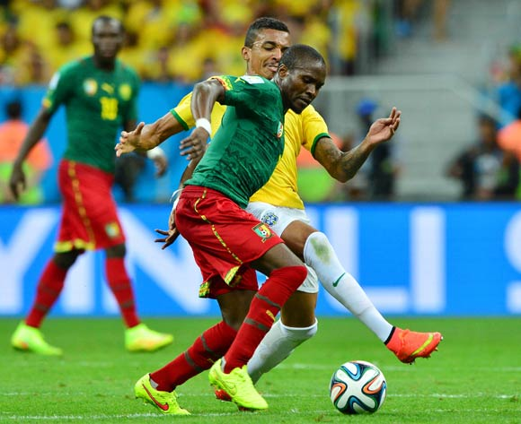 Landry Nguemo of Cameroon shields ball from Luiz Gustavo of Brazil during the 2014 Brazil World Cup Final Group A football match between Cameroon and Brazil at the Estadio Nacional Brasilia, Brazil on 23 June 2014