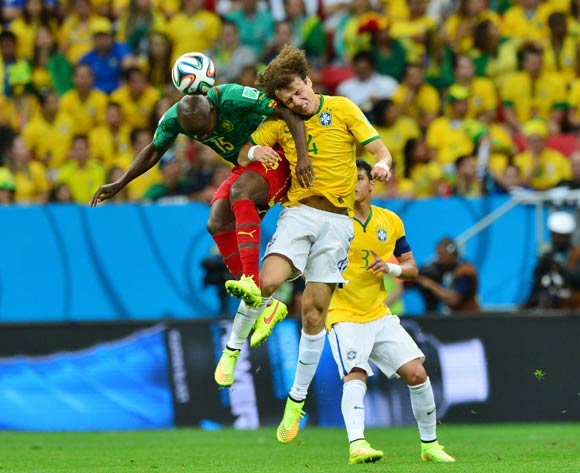 David Luiz of Brazil beats Pierre Webo of Cameroon in the air during the 2014 Brazil World Cup Final Group A football match between Cameroon and Brazil at the Estadio Nacional Brasilia, Brazil on 23 June 2014