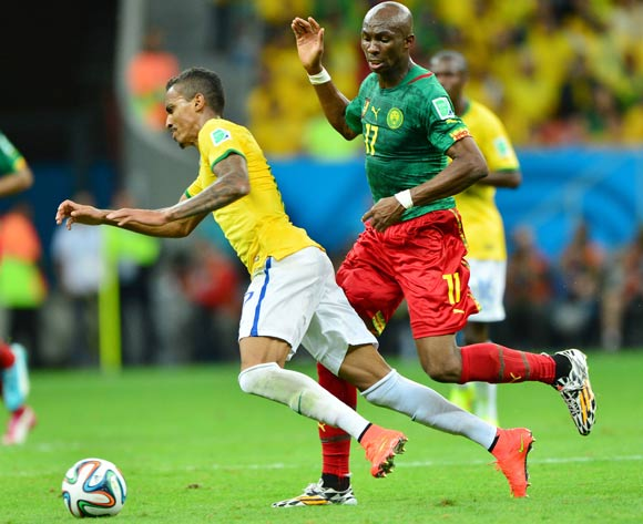 Luiz Gustavo of Brazil fouled by Stephane Mbia of Cameroon during the 2014 Brazil World Cup Final Group A football match between Cameroon and Brazil at the Estadio Nacional Brasilia, Brazil on 23 June 2014