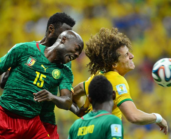 Pierre Webo of Cameroon beats David Luiz of Brazil in the air  during the 2014 Brazil World Cup Final Group A football match between Cameroon and Brazil at the Estadio Nacional Brasilia, Brazil on 23 June 2014