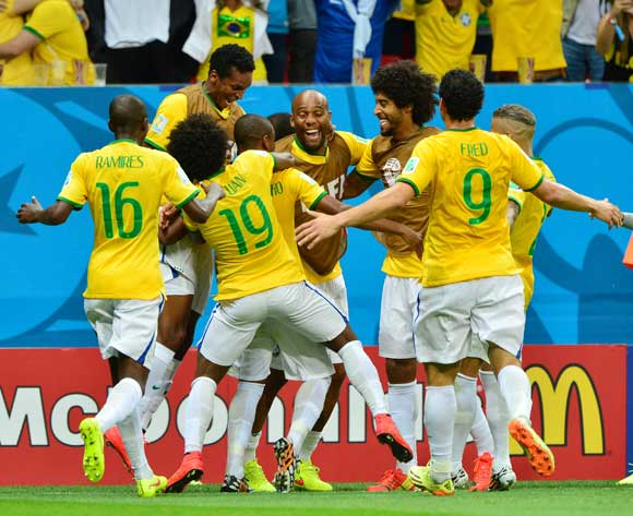 Brazil players celebrate Fernandinho's goal during the 2014 Brazil World Cup Final Group A football match between Cameroon and Brazil at the Estadio Nacional Brasilia, Brazil on 23 June 2014