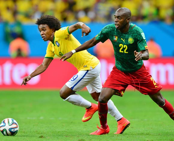 Willian of Brazil gets past Allan Nyom of Cameroon during the 2014 Brazil World Cup Final Group A football match between Cameroon and Brazil at the Estadio Nacional Brasilia, Brazil on 23 June 2014