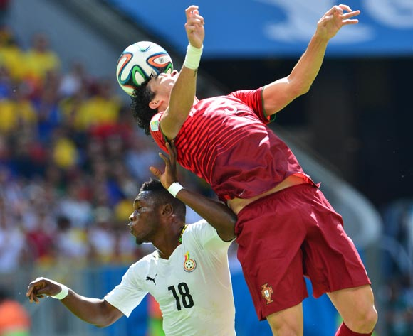 Pepe of Portugal and Majeed Waris of Ghana  challenge for the ball during the 2014 Brazil World Cup Final Group G football match between Portugal and Ghana at the Estadio Nacional Brasilia, Brazil on 26 June 2014