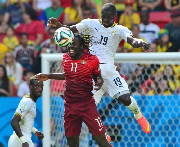 Jonathan Mensah of Ghana challenges Eder of Portugal during the 2014 Brazil World Cup Final Group G football match between Portugal and Ghana at the Estadio Nacional Brasilia, Brazil on 26 June 2014