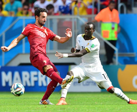 Mohammed Rabiu of Ghana tackles Ruben Amorim of Portugal  during the 2014 Brazil World Cup Final Group G football match between Portugal and Ghana at the Estadio Nacional Brasilia, Brazil on 26 June 2014