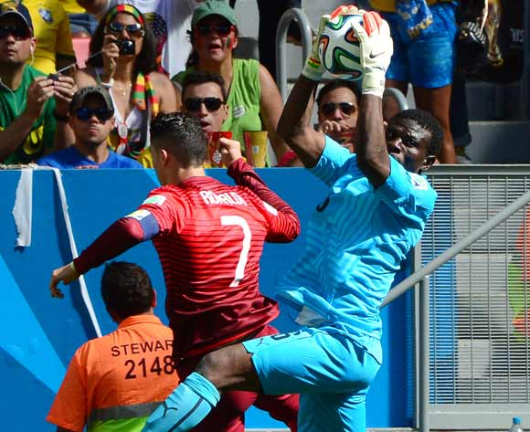 Fatawu Dauda of Ghana catches ball from Cristiano Ronaldo of Portugal during the 2014 Brazil World Cup Final Group G football match between Portugal and Ghana at the Estadio Nacional Brasilia, Brazil on 26 June 2014