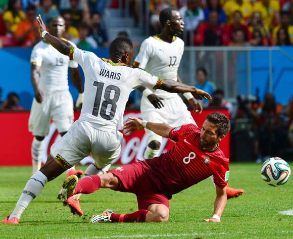 Joao Moutinho of Portugal misses tackle on Majeed Waris of Ghana during the 2014 Brazil World Cup Final Group G football match between Portugal and Ghana at the Estadio Nacional Brasilia, Brazil on 26 June 2014