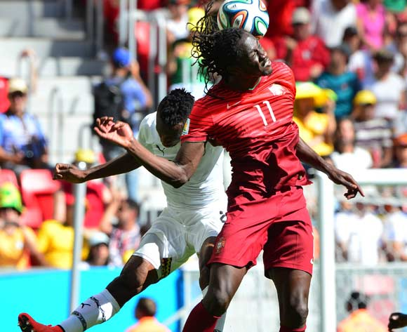 Eder of Portugal beats Harrison Afful of Ghana in the air during the 2014 Brazil World Cup Final Group G football match between Portugal and Ghana at the Estadio Nacional Brasilia, Brazil on 26 June 2014