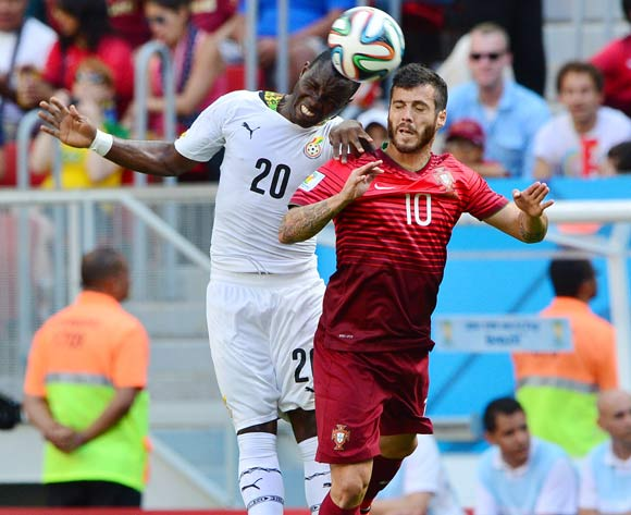 Kwadwo Asamoah of Ghana heads ball away from Vieirinha of Portugal  during the 2014 Brazil World Cup Final Group G football match between Portugal and Ghana at the Estadio Nacional Brasilia, Brazil on 26 June 2014