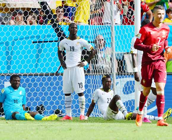Fatawu Dauda (l), Jonathan Mensah (c) and John Boye and look on dejectedly after Cristiano Ronaldo of Portugal scores during the 2014 Brazil World Cup Final Group G football match between Portugal and Ghana at the Estadio Nacional Brasilia, Brazil on 26 June 2014
