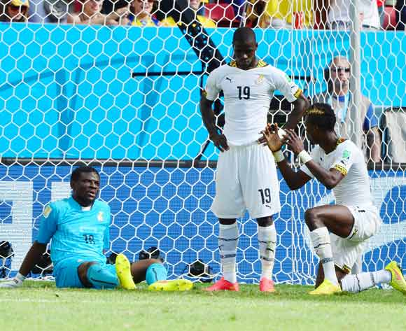 Fatawu Dauda (l), Jonathan Mensah (c) and John Boye discuss mistake after Cristiano Ronaldo of Portugal scores during the 2014 Brazil World Cup Final Group G football match between Portugal and Ghana at the Estadio Nacional Brasilia, Brazil on 26 June 2014