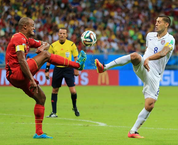 Belgium's Vincent Kompany (left) and USA's Clint Dempsey battle for the ball