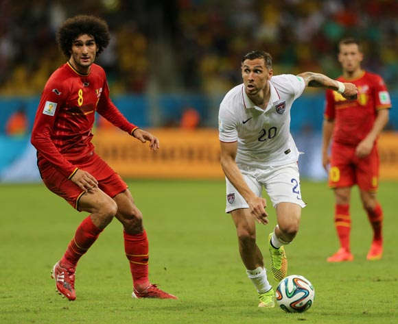 USA's Geoff Cameron (right) in action with Belgium's Marouane Fellaini