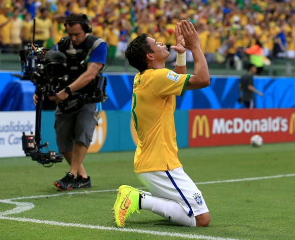 Brazil's Thiago Silva celebrates scoring his side's first goal of the match during the quarter final match at the Estadio Castelao, Fortaleza.