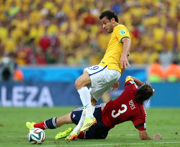 Brazil's Fred (top) and Colombia's Mario Yepes battle for the ball during the quarter final match at the Estadio Castelao, Fortaleza.