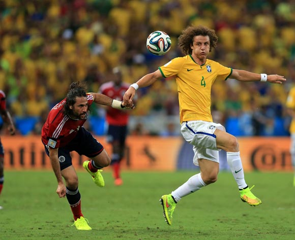 Colombia's Mario Yepes (left) and Brazil's David Luiz (right) battle for the ball during the quarter final match at the Estadio Castelao, Fortaleza.