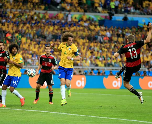 Germany's Thomas Muller scores his side's first goal of the game during the FIFA World Cup Semi Final at Estadio Mineirao, Belo Horizonte, Brazil.