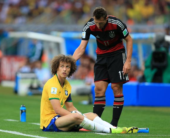 Brazil's David Luiz looks towards the referee for a decision as Germany's Miroslav Klose (right) stands over him during the FIFA World Cup Semi Final at Estadio Mineirao, Belo Horizonte, Brazil.