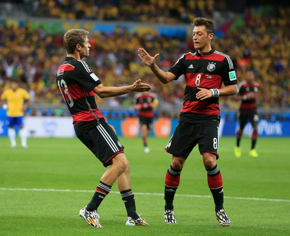Germany's Thomas Muller celebrates scoring his side's first goal of the game with teammate Germany's Mesut Ozil (right) during the FIFA World Cup Semi Final at Estadio Mineirao, Belo Horizonte, Brazil.