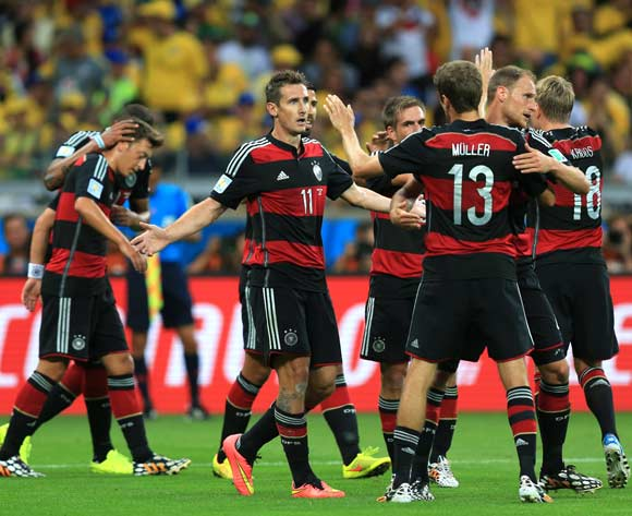 Germany's Miroslav Klose (left) celebrates scoring his side's second goal of the game with teammates during the FIFA World Cup Semi Final at Estadio Mineirao, Belo Horizonte, Brazil.