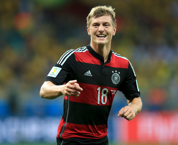 Germany's Toni Kroos celebrates scoring his side's third goal of the game during the FIFA World Cup Semi Final at Estadio Mineirao, Belo Horizonte, Brazil.