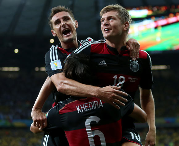 Germany's Toni Kroos celebrates scoring his side's fourth goal of the game with teammate Germany's Sami Khedira (6) and Miroslav Klose (left) during the FIFA World Cup Semi Final at Estadio Mineirao, Belo Horizonte, Brazil.