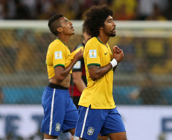 Brazil's Luis Gustavo (left) and Dante walk off the pitch dejected at half time during the FIFA World Cup Semi Final at Estadio Mineirao, Belo Horizonte, Brazil.