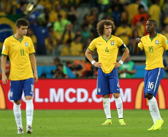 (left to right) Brazil's Oscar, David Luiz and Ramires dejected during the FIFA World Cup Semi Final at Estadio Mineirao, Belo Horizonte, Brazil.