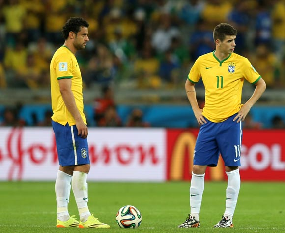 (left to right) Brazil's Fred and Oscar dejected at the kick off for the second half during the FIFA World Cup Semi Final at Estadio Mineirao, Belo Horizonte, Brazil.