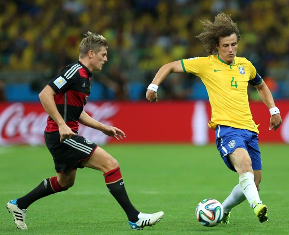 Brazil's David Luiz (right) and Germany's Toni Kroos (left) battle for the ball during the FIFA World Cup Semi Final at Estadio Mineirao, Belo Horizonte, Brazil.